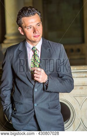 Dressing Formally, One Hand Putting In The Pocket And One Hand In The Front Of Chest, A Young Busine