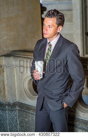 Dressing Formally, One Hand Putting In The Pocket And One Hand Holding A Cup Of Coffee, A Young Busi