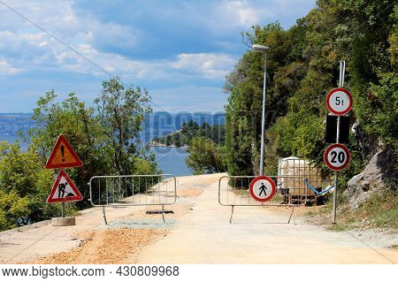 Closed Road Under Construction With Various Road Signs From 20 Speed Limit And 5t Weight Limit To Wa