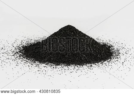 A Pile Of Activated Carbon. Raw Material In Water Purifier. Activated Carbon On White Background.