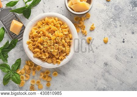 Pasta. Italian Pasta. Insalata Di Pasta And Vegetables Cooking Ingredients, Cheese And Basil On Old