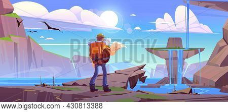 Traveler With Map At Mountain Waterfall Landscape With Beautiful Lake And Rocks Under Blue Cloudy Sk