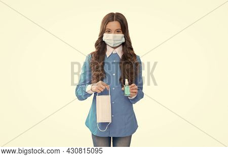 Girl Child Holding Protective Mask And Sanitizer For Cleaning Hands Isolated On White Keep Safe Of C