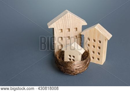 Multi-storey Houses And Small House In The Nest. Parenting Concept. Investing In Real Estate. Constr