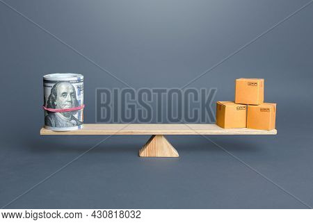 Dollars Bundle And Boxes On Scales. Trade Balance And Purchasing Power. Commerce And Business. Trade