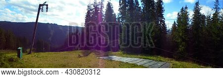 Panoramic Scene Of Mountain Nature,forests And Meadows. Nature Scene From A Skislope Top. Bright Sun