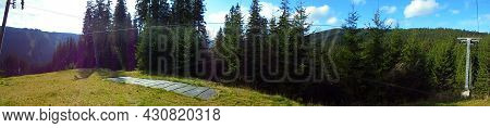 Panoramic Scene Of Mountain Nature,forests And Meadows. Nature Scene From A Skislope Top. Bright Blu