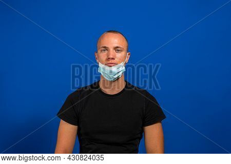 Protection Against Contagious Disease, Coronavirus, Covid-19. Man Wearing Hygienic Mask To Prevent I