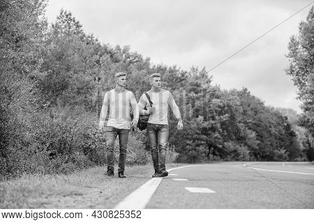 Guys Hitchhiking On Road. Tourist Traveler Travel Auto Stop. Transporting Issues. Men Backpack Walki