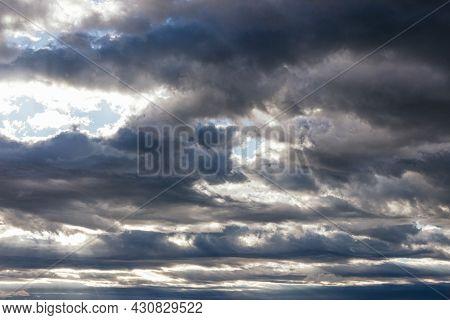 Sunbeams Through The Gray Clouds Of The Storm Sky, Cumulonimbus