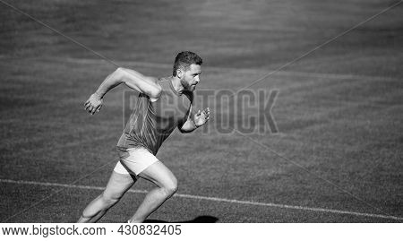Energetic Athletic Muscular Man Runner Running Outdoor On Green Grass, Copy Space, Success