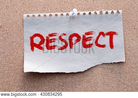 The Word Respect In Cut Out Magazine Letters Pinned To A Cork Notice Board.