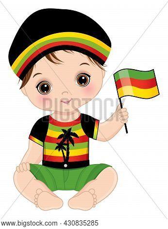 Curly Baby Boy Sitting And Holding Flag. Little Brunette Baby Boy With Hazel Eyes Wearing Rastafaria