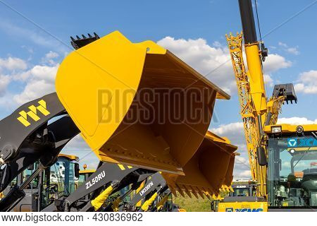 The Lifted Bucket Of The New Xcmg Heavy Wheel Loader, Close-up. Construction Equipment At The Bauma
