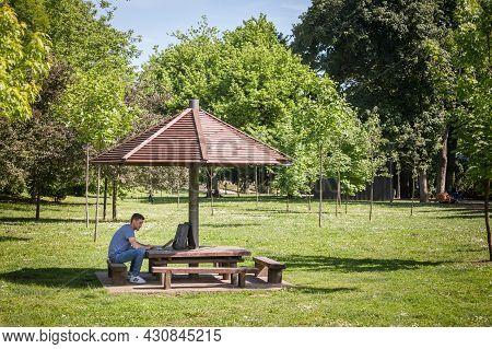 Pancevo, Serbia - May 22, 2021: Man, Online Male Worker, Digital Nomad, Freelancer, Working Outsidea