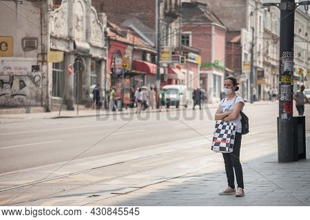 Belgrade, Serbia - July 24, 2021: Woman, A Young Girl, Standing Alone Wearing Face Mask Respiration