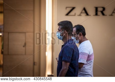 Belgrade, Serbia - July 30, 2021: Indian Tourists, Two Middle Aged Male Men From India, Walking In A