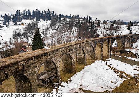 Vorokhta, Ukraine March 31, 2021: Walk Along The Old Viaduct Bridge, Wedding In Winter.
