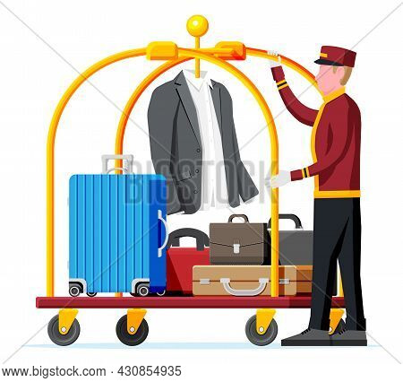 Hotel Luggage Cart And Bellhop Character. Bellboy Worker With Hotel Baggage Trolley With Bags Isolat