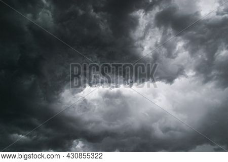 Swirling Angry Menacing Dark Grey Stormy Clouds