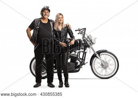 Elderly man biker in embrace with a woman standing in front of a chopper isolated on white background