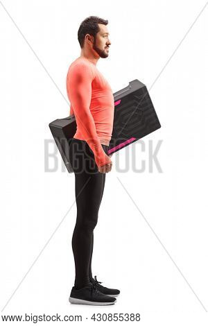 Full length profile shot of a man holding a step aerobic platform isolataed on white background