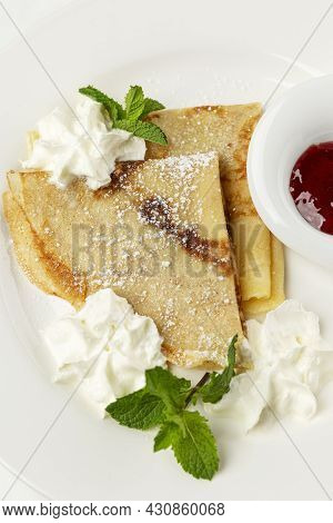 Thin Pancakes With Cream And Berry Sauce. Traditional Mouth-watering Dish. Close-up.