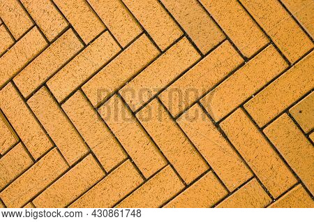 Yellow Block Pavior Driveway. Seamless Texture Of Street Tiles. Pattern Of Yellow Sidewalk Tiles. Pa