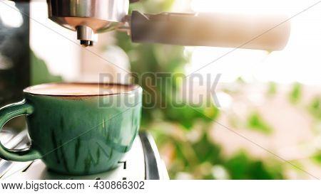 Green Cup Of Coffee On Coffee Maker Machine With Dispenser. Mug Full Of Espresso, Americano Or Cappu