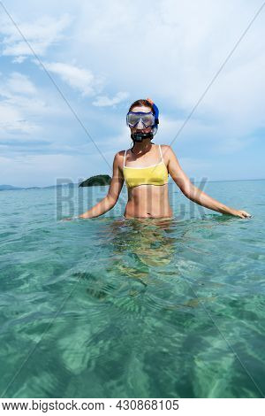Girl Snorkeling With Snorkel And Mask In Clear Sea Water On The Beach.