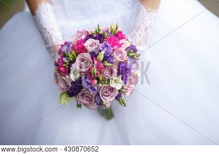 Wedding Bouquet Of White Red And Pink Roses In Bride Hands