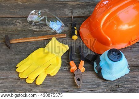 Construction Tools And Means Of Protection On An Old Wooden Background.