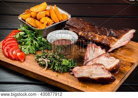 Bbq Grilled Ribs On A Wooden Board