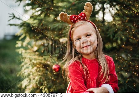 Christmas In July. Child Waiting For Christmas In Wood In July. Portrait Of Little Girl Decorating C