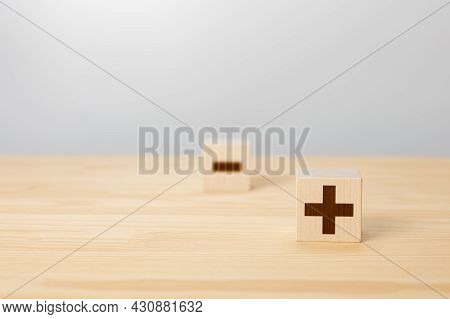 Pros And Cons Concept. Choosing Plus With Blurred Minus Symbol. Concept Of Opposites, Wood Block Wit
