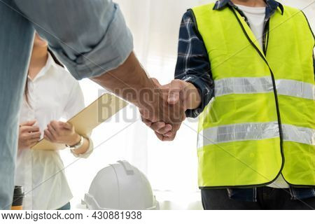 Group Of Architect And Engineer Construction Worker Partner Handshake In Meeting Room Office At Cons