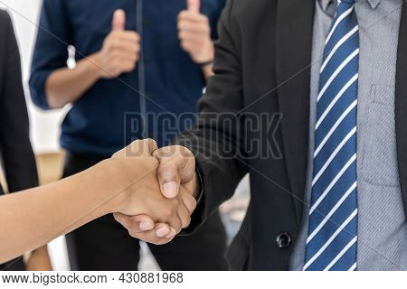 Group Of Business People Partnership Handshaking After Good Deal In Meeting Room At Office, Congratu