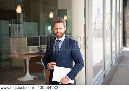 Mature Smiling Businessman In Businesslike Suit Hold Wireless Laptop Outside The Office, Business