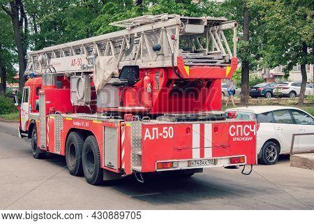 Krasnodar, Russia - July 27 2021: Fire Trucks Ladder Truck During A Rescue Mission. Big Fire Truck.