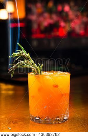 Refreshing Summer Drink Sea-buckthorn Juice In Glass, Decorated With Rosemary