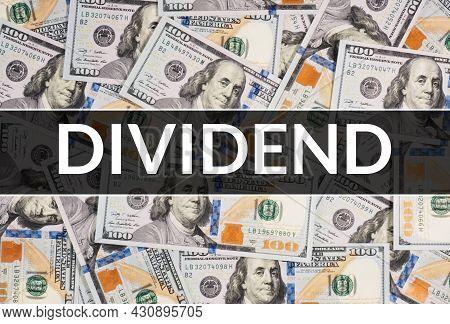 Text Dividend On Dollar Bills Background. Financial Market Concept