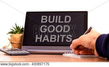 Build Good Habits Symbol. Tablet With Words 'build Good Habits'. Businessman Hand With Pen, House Pl
