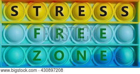 Stress Free Zone Symbol. Words 'stress Free Zone' On Rainbow Pop It. Beautiful Background, Copy Spac