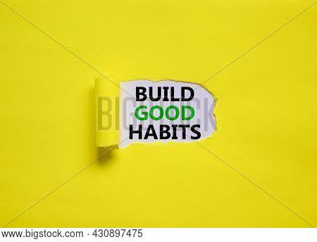 Build Good Habits Symbol. Words 'build Good Habits' Appearing Behind Torn Yellow Paper. Beautiful Ye