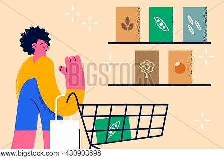 Healthy Diet And Lifestyle Concept. Young Smiling Female Standing In Grocery Store Choosing Fresh In
