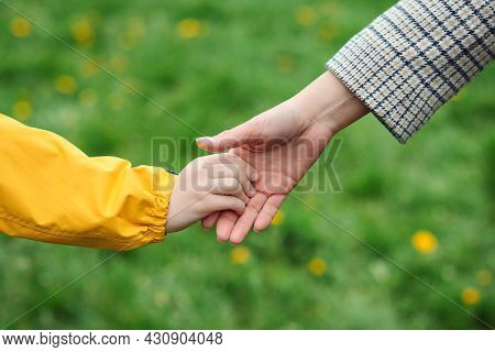 Mother And Child Hands Reaching To Each Other. Support, Help And Trust. Parent Holds The Hand Of A C
