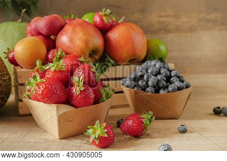 Fresh Fruits. Healthy Food. Mixed Fruit, Apricots And Peaches. Blueberry. Various Fruits On An Old W