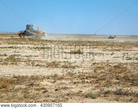 Bulldozer In The Steppes Level The Site. Kazakhstan. Oil Field. Mangistau Region. August 17, 2019 Ye