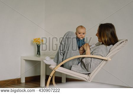 A Young Mother Is Play With Little Baby Boy. Mother Of A Nursing Baby