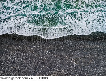 Stormy Weather, Sea Waves Breaking On A Shore With Volcanic Black Sand, Background With Copy Space
